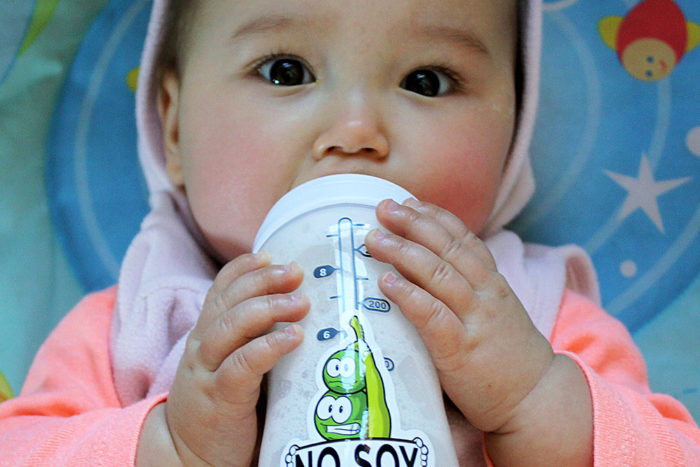 baby drinking milk. AllerWare